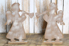 Two figure of an angel with a trumpet made wood. Royalty Free Stock Photo