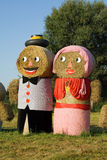 Two figures made out of straw bales Stock Image