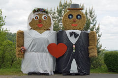 Two figures made out of straw bales, marriage Stock Images