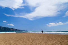 Two figures of the person in the distance on a beach to Iztuz, T Royalty Free Stock Photography