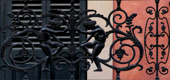 Two figures. Shot in color, detail on an iron sculpture representing two male figures, placed on the balcony of this historic building, set in Palma de Mallorca Royalty Free Stock Images