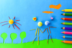 Children`s play:people in love. Two figurines in love on blue background Stock Photography