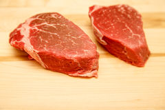 Two Filet Mignon Steaks on Wood Cutting Board Stock Images