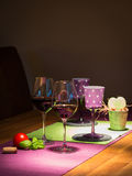 Two filled red wine glasses on wooden table Stock Photo