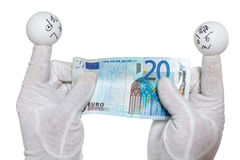 Two finger puppets holding twenty euro note Royalty Free Stock Photography