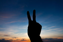 Two finger shape hand silhouette Stock Images