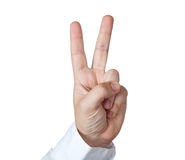 Two fingers. Holding two fingers in a piece gesture. Clipping path Royalty Free Stock Images