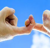 Two fingers  with blue sky Royalty Free Stock Photo