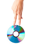 Two fingers on cd disk Stock Image