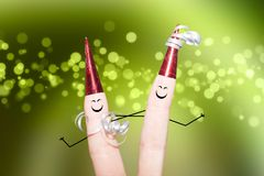 Two fingers dancing on a party bokeh light effects green background Stock Photo