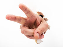 Two fingers. Hand pointing two fingers breakthrough white paper Royalty Free Stock Photography