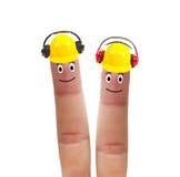 Two fingers in helmet with headphones Stock Photos
