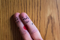 Two fingers hugging Stock Photo