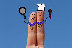 Two fingers painted as a cookers Royalty Free Stock Photography