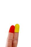 Two fingers with painted fingertips. On white background stock photos