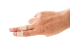 Two fingers patched. With plaster on white background Royalty Free Stock Photography