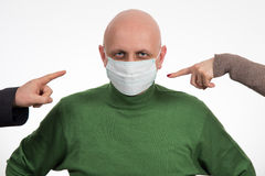 Two fingers pointing at Flu illness young man in medicine healthcare mask Stock Image