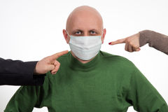 Two fingers pointing at Flu illness young man in medicine healthcare mask Stock Photos