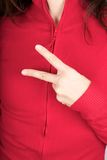 Two fingers symbol on red sweater Royalty Free Stock Photo