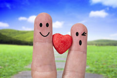 Two fingers are symbols of love couples, Stock Photography