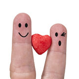 Two fingers are symbols of love couples,one red heart of Stock Images