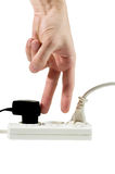 "Two fingers about to be ""plugged"" into a socket. (in a multiple outlet Stock Image"