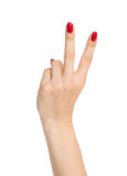 Two fingers up in the peace or victory symbol the sign for V let. Hand with two fingers up in the peace or victory symbol the sign for V letter in sign language Royalty Free Stock Photos