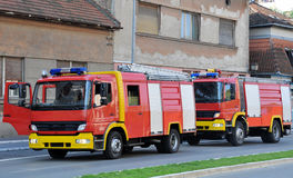Two fire engines arrived at the scene of the fire extinguishing Royalty Free Stock Photo