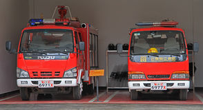 Two fire engines in garage, Lijiang, China Stock Photography