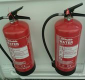Two fire extinguishers Royalty Free Stock Photography