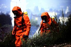 Free Two Fire Fighters In Hazmat Suits Outdoors Stock Photo - 209992450