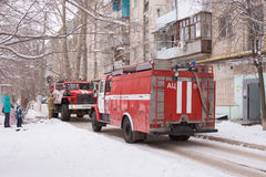 Two fire service cars are in the yard of a block of flats Royalty Free Stock Photos