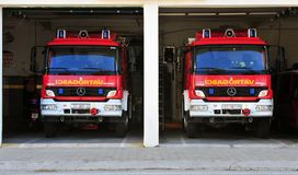 Two fire trucks, Omis town, Croatia. OMIS, CROATIA - MARCH 11: Two fire trucks at the station, Omis town, Croatia on March 11, 2017 Royalty Free Stock Photos