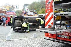 Firefighters in action on accident. Two firefighters in action to remove injured people from inside car crash Stock Photography