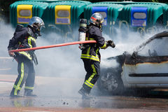 Two firefighters in action Stock Photography