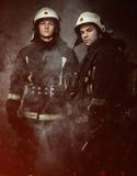 Two firefighters Stock Images