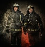 Two firefighters in a smoke royalty free stock photos