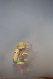 Two firefighters is working surround with smoke. With copy space or space for text Stock Images