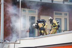 Two firemen Royalty Free Stock Images