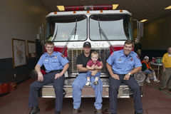 Two firemen, father and son Stock Photography