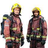 Two firemen isolated. Stock Photos