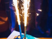 Two fireworks. In the cake at party royalty free stock photo