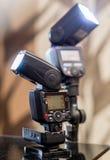 Two firing speedlights. Two  powerfull firing speedlights for photographer Stock Image