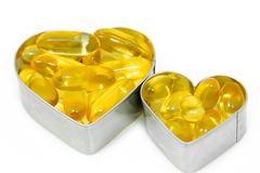 Two Fish Oil pills on Heart   Royalty Free Stock Photography