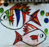 Two fish painted on wall Stock Photos