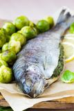 Two fish, rainbow trout stuffed with green herb sauce Royalty Free Stock Photos