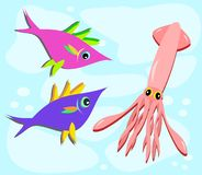 Two Fish and a Squid. Here are a couple of curious Fish checking out a Squid Stock Image