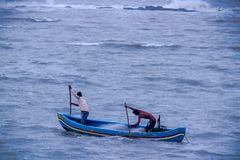 Two Fisherman in the boat in the arabian sea , Mumbai, India royalty free stock photography