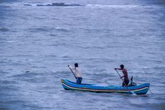 Two Fisherman in the boat in the arabian sea , Mumbai, India royalty free stock image