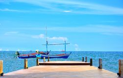 Two fisherman boat has wooden bridge in  sea with blue sky backg Stock Photography